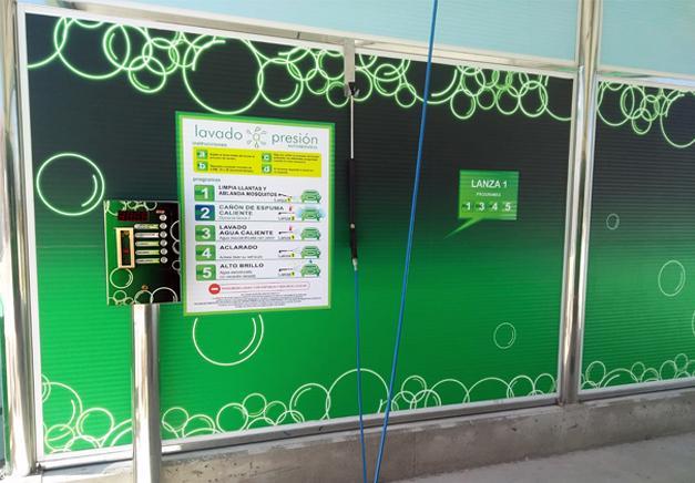 Rotulación y señalética realizada en vinilo para lavadero de la BP. Rótulos Art Design.